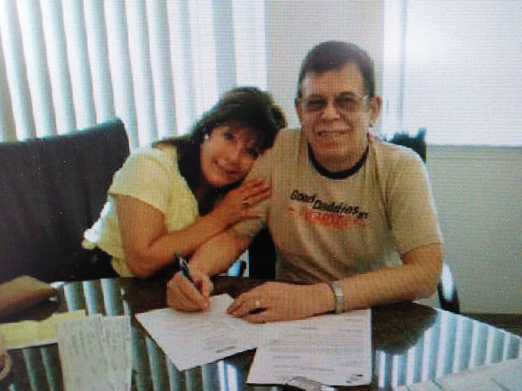 Special to the Pahrump Valley Times Karen Jackson and Art Bell finalize their agreement when Jackson purchased Pahrump's KNYE 95.1 FM as shown in a file photo.
