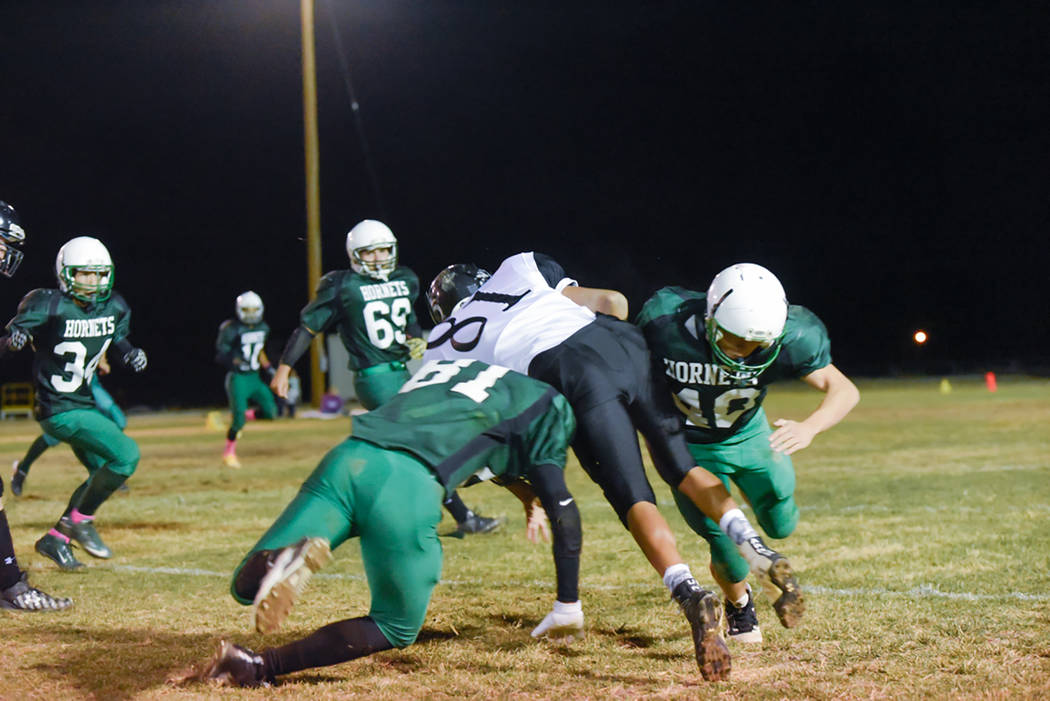 Skylar Stephens / Special to the Pahrump Valley Times Beatty players Jake Ybarra and Michael Olson make a tackle during a 2016 game against Round Mountain. The Hornets and Knights no longer will b ...