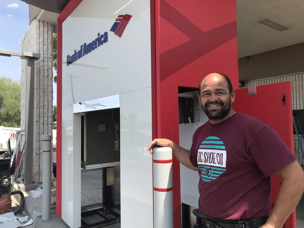 Jeffrey Meehan/Pahrump Valley Times Royce Avena of Avena & Sons Electric LLC stands at the Pahrump branch of Bank of America on July 26, 2018. Avena helped install a new ATM machine at the branch ...