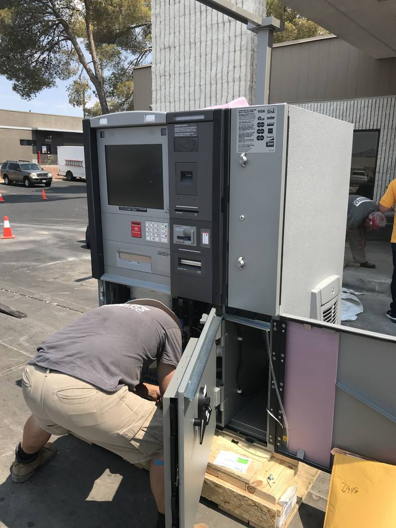 Jeffrey Meehan/Pahrump Valley Times Crewman from San Diego, California-based Withers Inc. work on installing a new ATM at Bank of America in Pahrump on July 26, 2018.