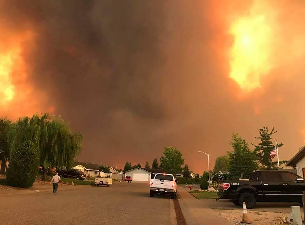 Special to the Pahrump Valley Times Shasta County, California resident Randy Ledbetter captured this image of his neighborhood just before evacuating the Carr fire in Redding, California. Ledbette ...