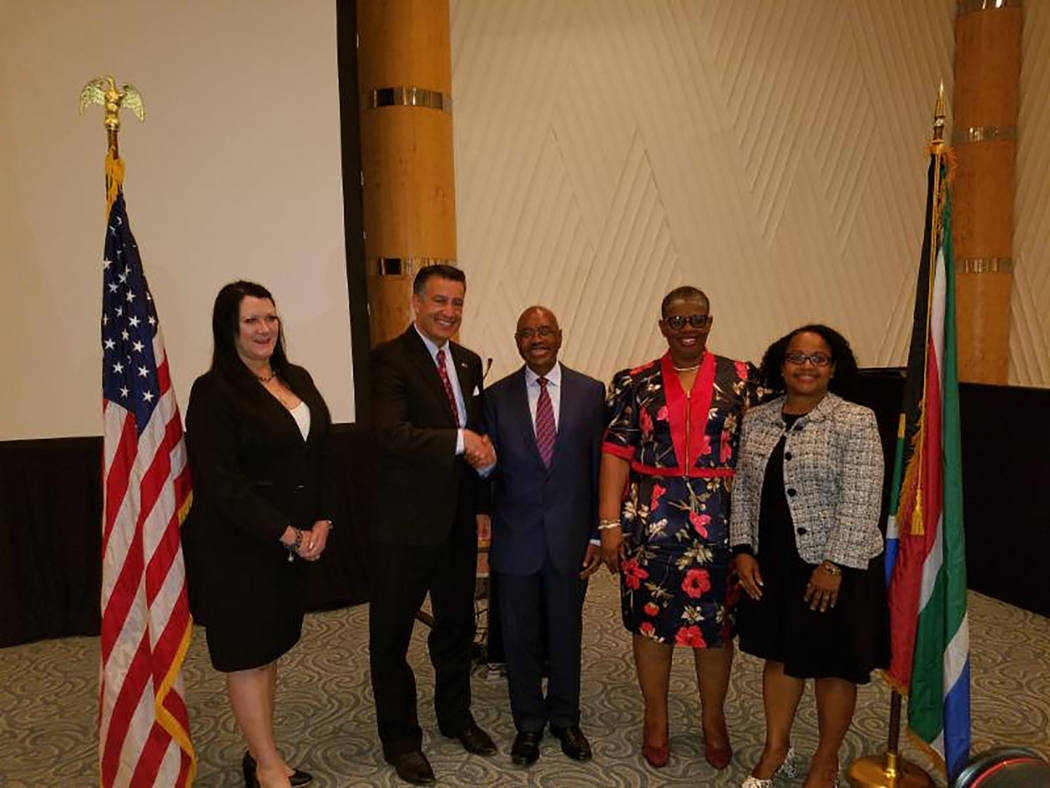 Nevada Governor's Office for Economic Development Nevada Gov. Brian Sandoval is shown meeting with Belinda Francis Scott, KwaZulu Natal Minister of the Executive Council for Finance, Premier Themb ...