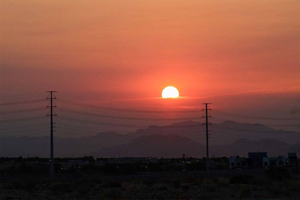 Max Michor/Las Vegas Review-Journal The sun rises in Nevada on Friday, Aug. 3, 2018. Smoke from wildfires in California continued to drift into Nevada. This photo was taken in Southern Nevada at S ...