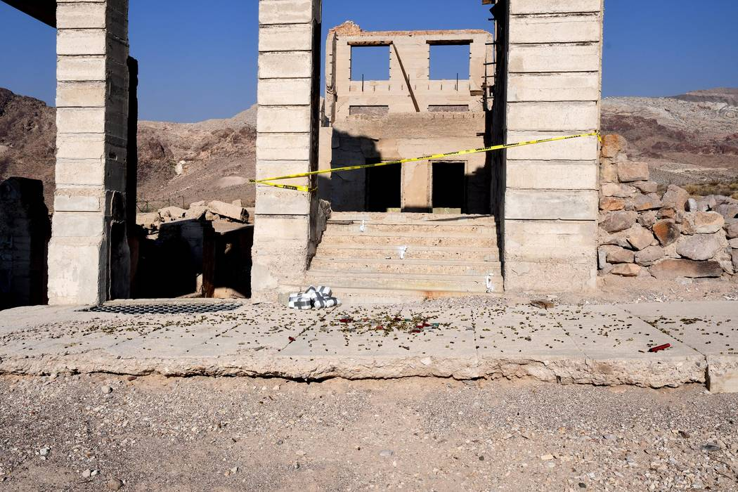 Richard Stephens/Special to the Pahrump Valley Times Spent shotgun shells, yellow caution tape and wrapped bundles possibly used as props to resemble packages of drug contraband litter the front s ...