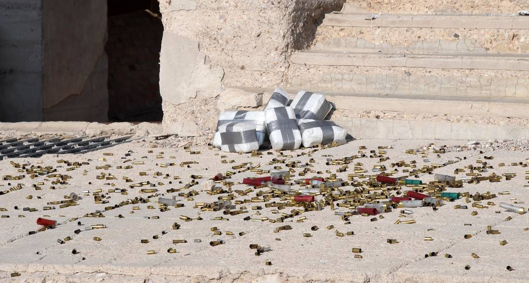Richard Stephens/Special to the Pahrump Valley Times Hundreds of empty shotgun, rifle and pistol cartridges of various calibers were left on the sidewalk in front of the steps of the Cook Bank bui ...