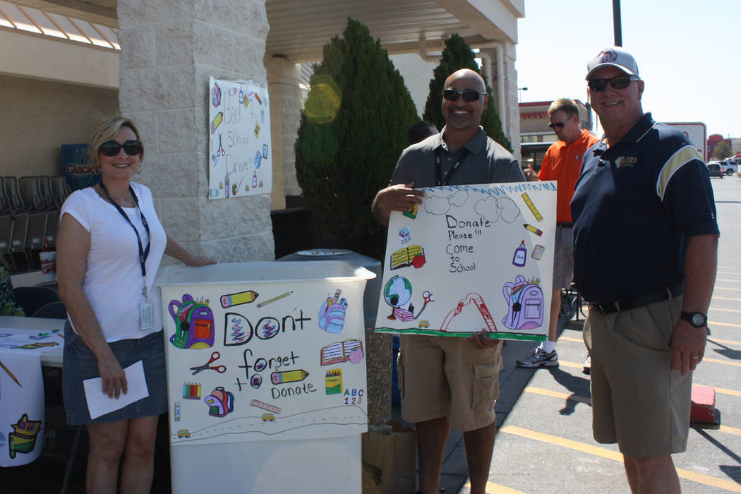 Robin Hebrock/Pahrump Valley Times Nye County School District Superintendent Dale Norton, far right, stands with two school district staff members who were volunteering at Smith's during the Fill ...