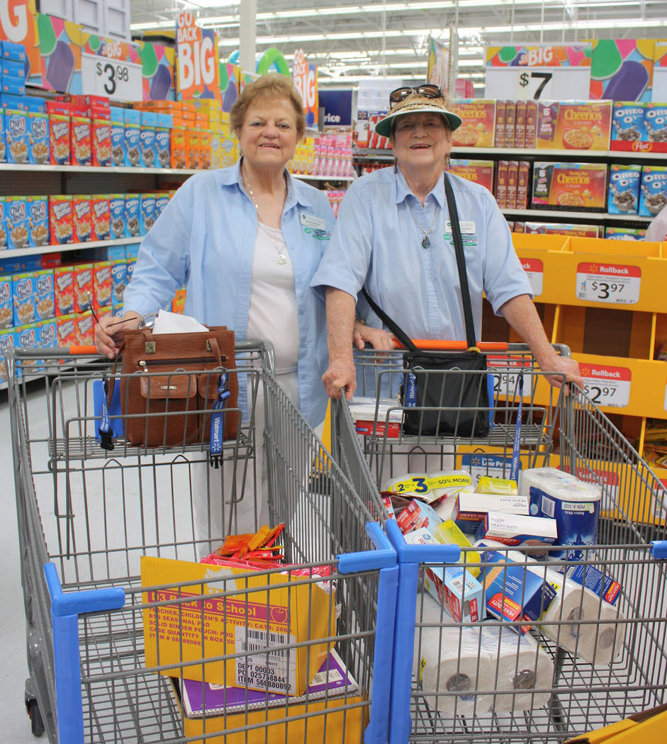 Robin Hebrock/Pahrump Valley Times Two VEA Ambassadors were spotted shopping for additional school supplies with the cash donations made by generous Fill the Bucket patrons.