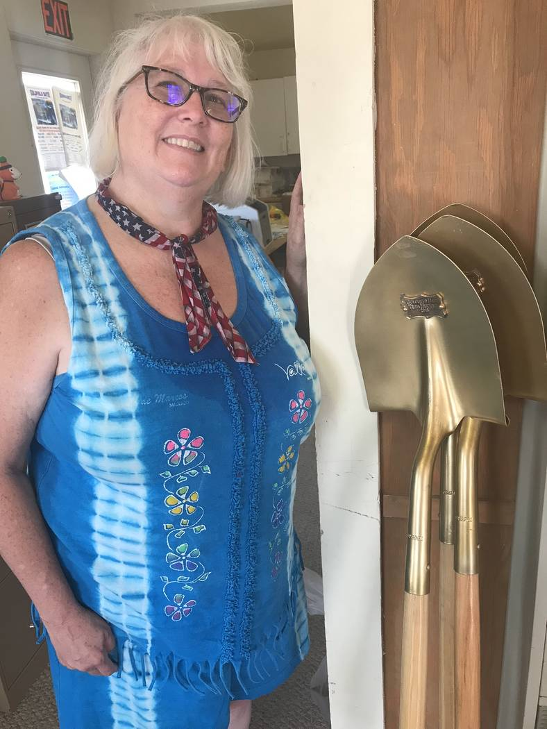 Jeffrey Meehan/Pahrump Valley Times Goldfield Chamber of Commerce President Patty Huber-Beth stands at the chamber headquarters at 165 Crook Ave. on Aug. 3, 2018 next to the top prizes for the ina ...