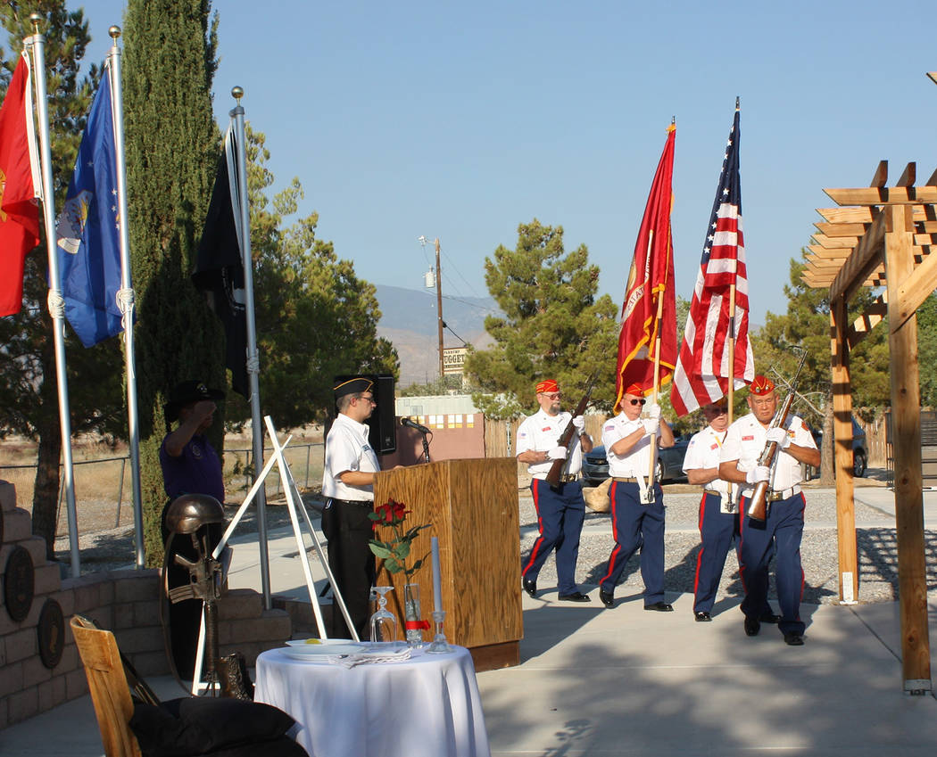 Robin Hebrock/Pahrump Valley Times The Marine Corps League Honor Guard presents the colors during the Purple Heart Day sundown ceremony.