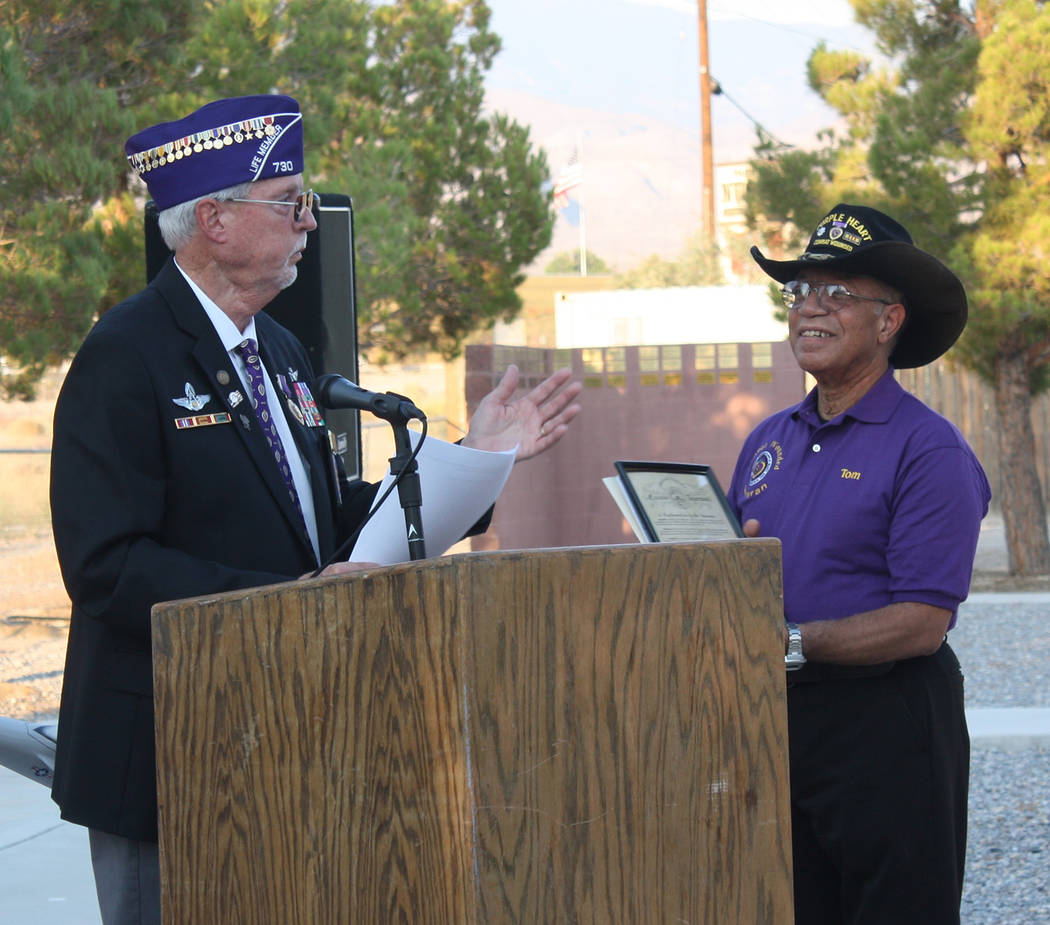 Robin Hebrock/Pahrump Valley Times Dr. Tom Waters receives the governor's proclamation naming August 7 Purple Heart day in Nevada from Military Order of the Purple Heart Commander Dan Peterson.