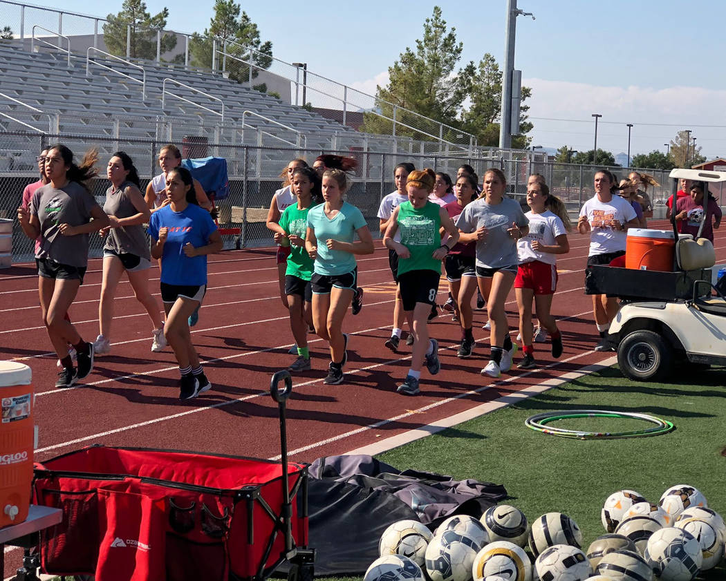 Tom Rysinski/Pahrump Valley Times The Pahrump Valley High School girls soccer team runs a lap before a recent practice at the school.