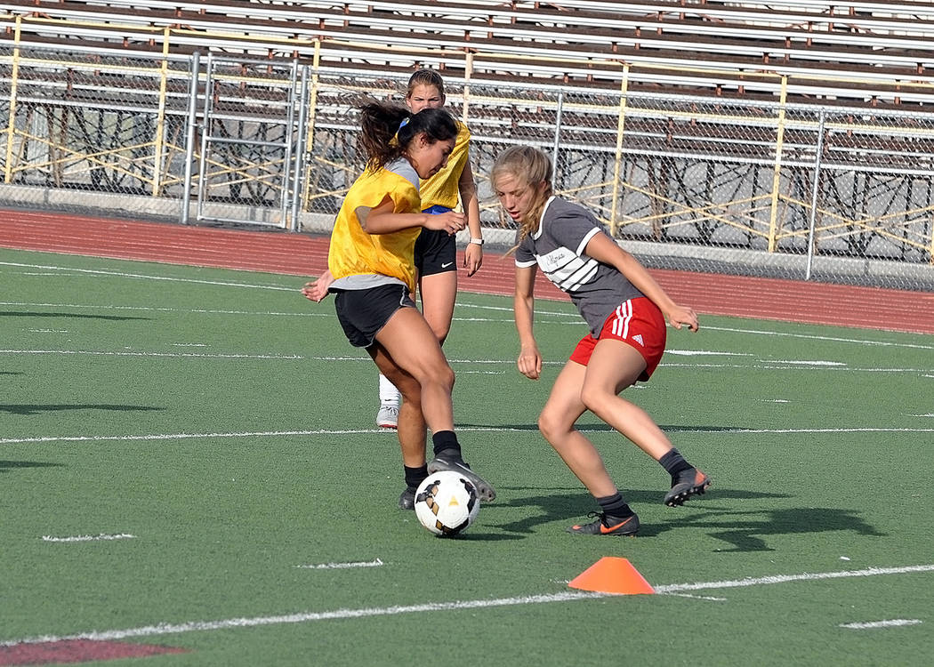 Horace Langford Jr./Pahrump Valley Times Senior Kimberly Ramos, left, and sophomore Juliana Hemphill square off during Pahrump Valley High School girls soccer practice Monday at the school.
