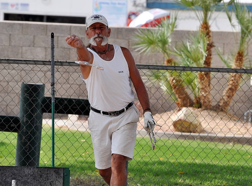 Horace Langford Jr./Pahrump Valley Times Dok Hembree pitches during B Division competition at the Shade Tree Open horseshoes tournament on Saturday morning at Petrack Park in Pahrump.