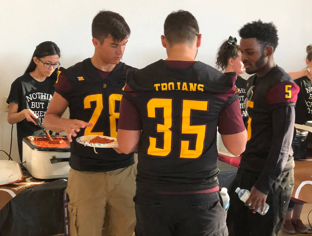 Tom Rysinski/Pahrump Valley Times Varsity football players, including Dylan Grossell (28), Nico Velazquez (35) and Casey Flennory (5), were the first in line at the spaghetti dinner, as they were ...