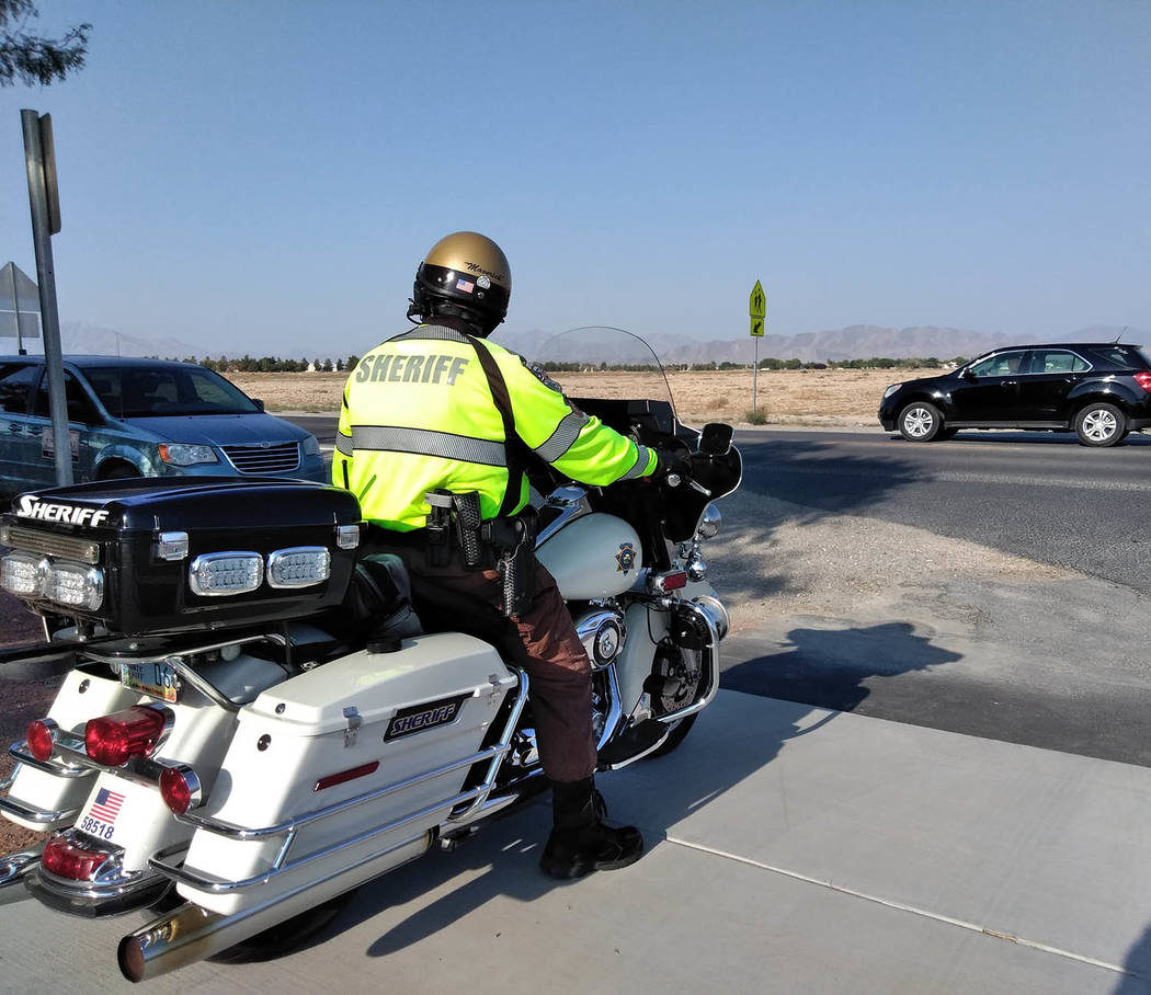 Selwyn Harris/Pahrump Valley Times As Assistant Superintendent Lindberg was voicing his concern about student safety at bus stops and school campuses, a Nye County Sheriff's Office motorcycle de ...