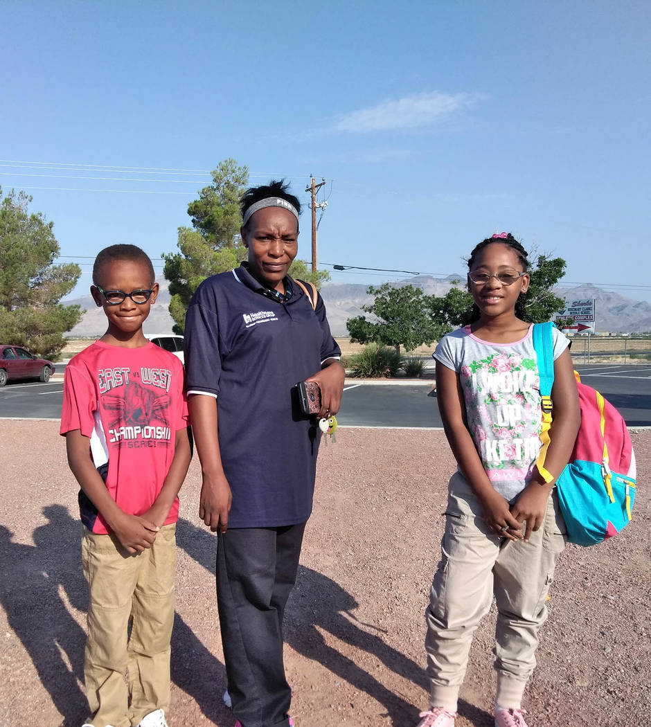 Selwyn Harris/Pahrump Valley Times local resident and mother Lesa Chandler, center, snapped a photo of her son, Damarion, left, and daughter Destiney prior to escorting the siblings on campus. Ch ...