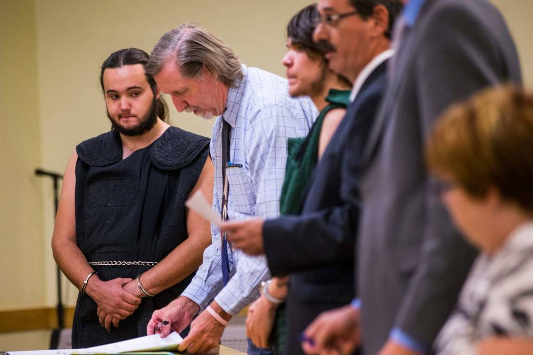 Dakota Saldivar, left, and Michael Wilson, center, appear for their arraignment in Pahrump Justice Court on Thursday, Aug. 9, 2018. The 17-year-olds face charges in the stabbing death of their mot ...