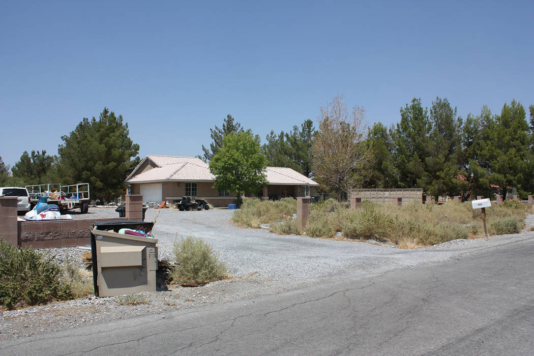Robin Hebrock/Pahrump Valley Times A view of the home at 2650 River Plate Dr., which has been condemned by the county.