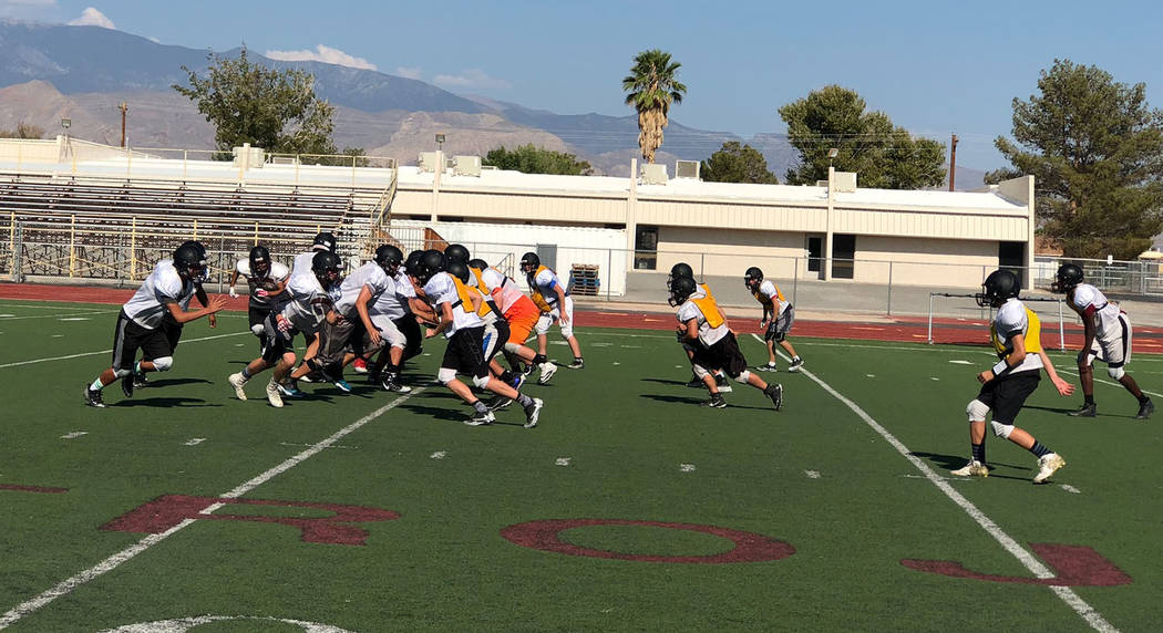 Tom Rysinski/Pahrump Valley Times The Pahrump Valley High School football team runs a play during practice Monday at the school in preparation for Friday night's opening game at Lowry.
