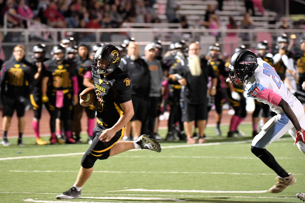 Peter Davis/Special to the Pahrump Valley Times Tyler Floyd, shown heading for the end zone last year against Western, will take over this year at quarterback for the Pahrump Valley High School fo ...