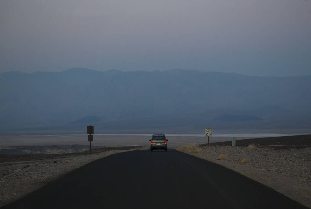 Death Valley National Park custodian Terry Eddington drives to the maintenance area where she begins her shift in Death Valley National Park, Calif., on Tuesday, Aug. 7, 2018. Chase Stevens Las Ve ...