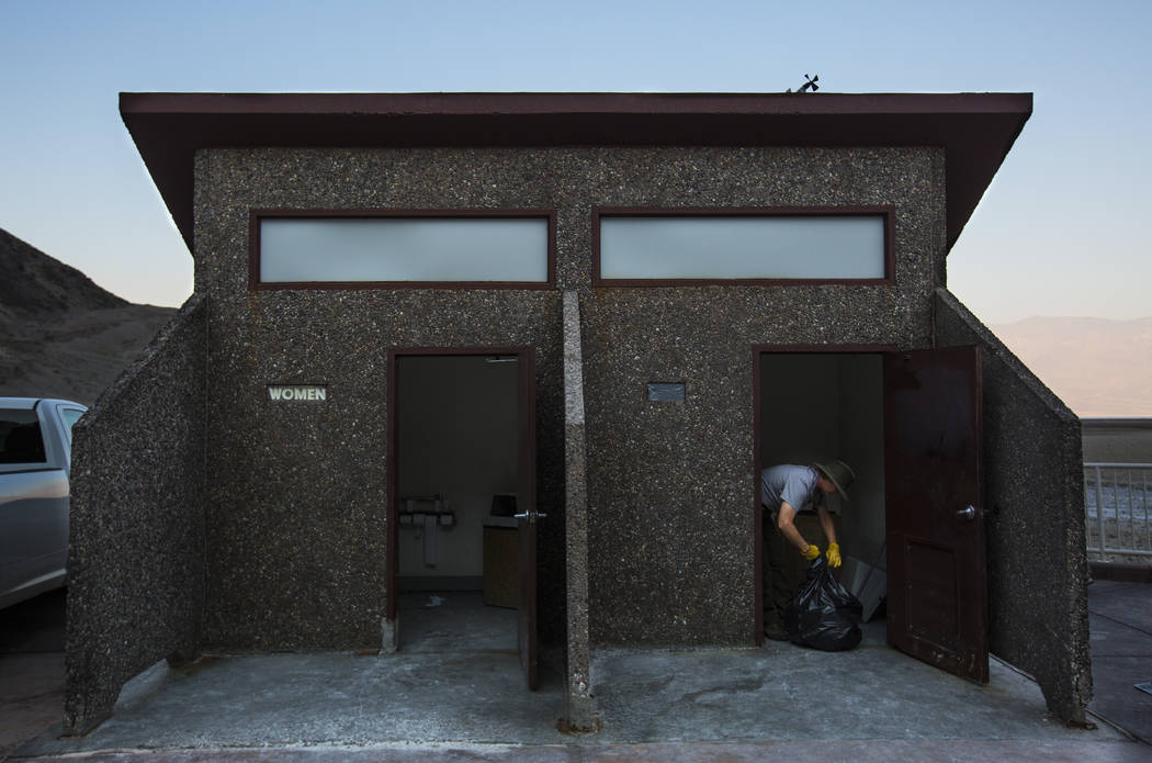 Death Valley National Park custodian Terry Eddington picks up trash while cleaning restrooms at Badwater Basin in Death Valley National Park, Calif., on Tuesday, Aug. 7, 2018. Chase Stevens Las Ve ...