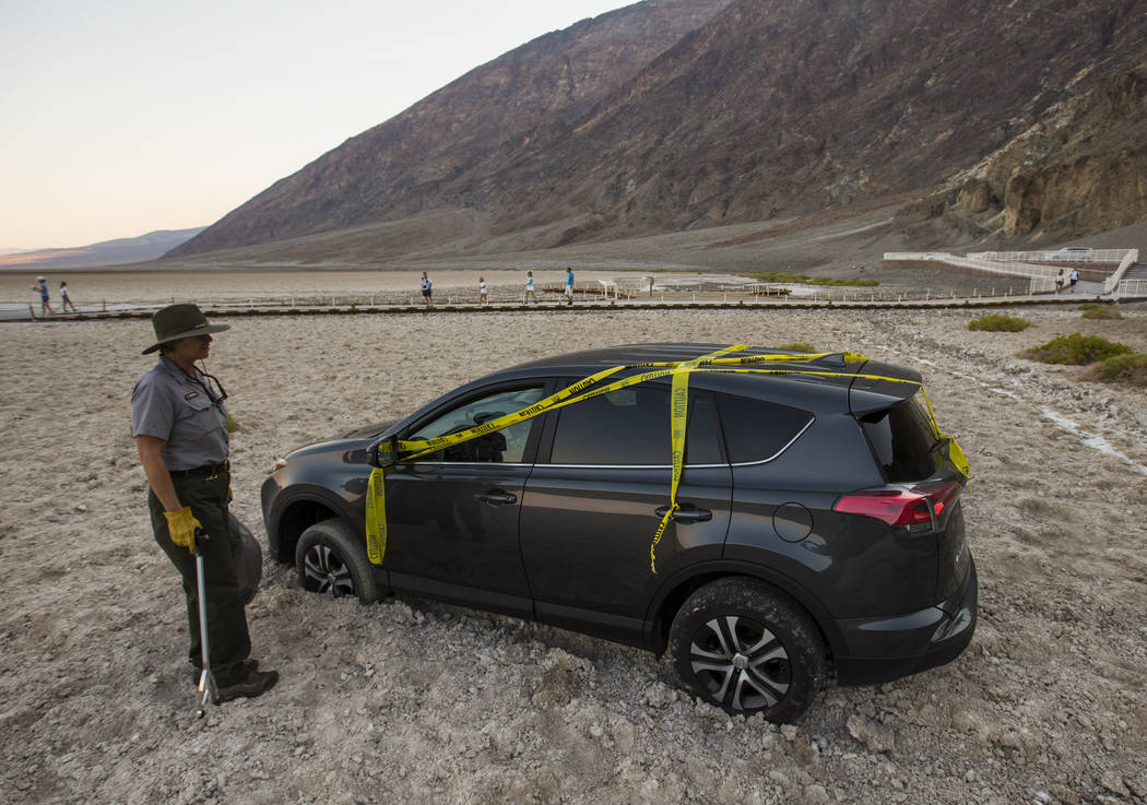 Death Valley National Park custodian Terry Eddington looks at a car that illegaly drove into Badwater Basin in Death Valley National Park, Calif., on Tuesday, Aug. 7, 2018. Chase Stevens Las Vegas ...