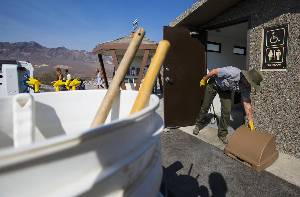 Death Valley National Park custodian Terry Eddington cleans restrooms at the pay station area along CA-190 in Death Valley National Park, Calif., on Tuesday, Aug. 7, 2018. Chase Stevens Las Vegas ...