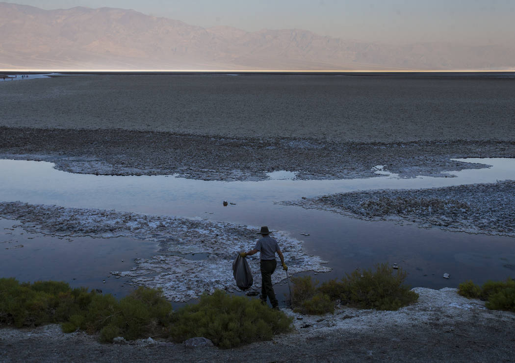 Death Valley National Park custodian Terry Eddington picks up trash around Badwater Basin in Death Valley National Park, Calif., on Tuesday, Aug. 7, 2018. Chase Stevens Las Vegas Review-Journal @c ...