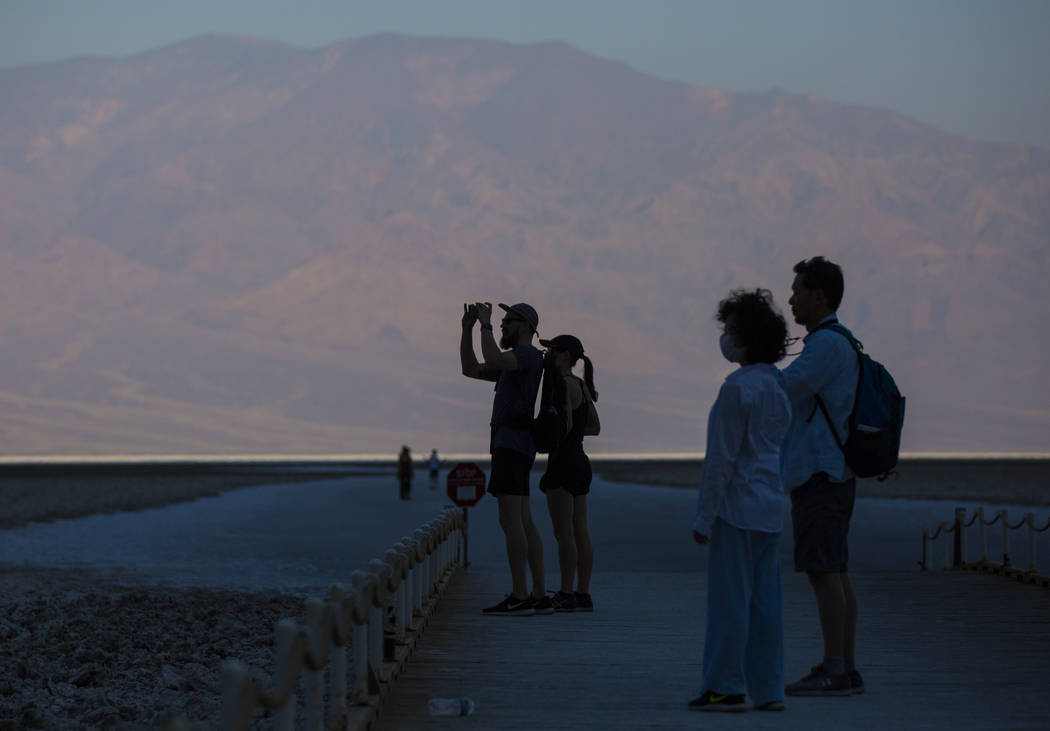 Visitors take photos at Badwater Basin in Death Valley National Park, Calif., on Tuesday, Aug. 7, 2018. Chase Stevens Las Vegas Review-Journal @csstevensphoto