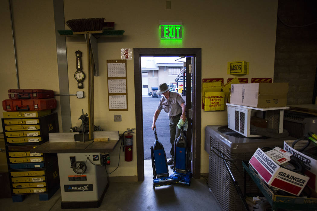 Death Valley National Park custodian Terry Eddington moves vacuums to her truck to be dropped off during her shift in Death Valley National Park, Calif., on Tuesday, Aug. 7, 2018. Chase Stevens La ...
