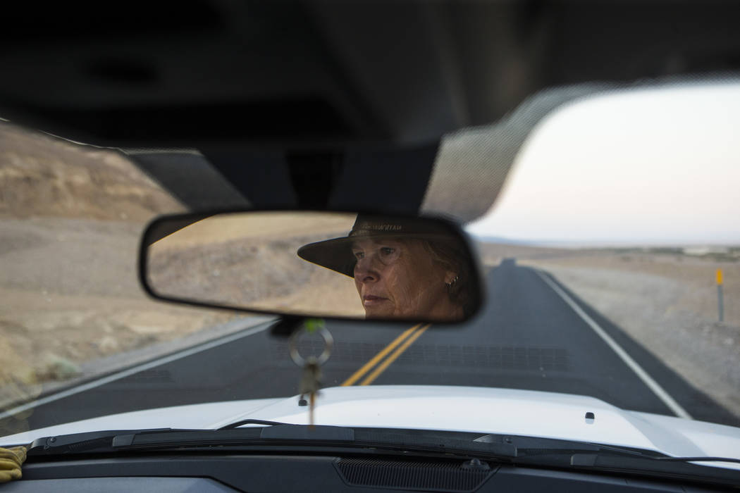Death Valley National Park custodian Terry Eddington heads to Badwater Basin at the start of her shift in Death Valley National Park, Calif., on Tuesday, Aug. 7, 2018. Chase Stevens Las Vegas Revi ...