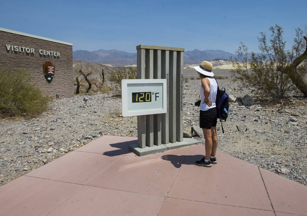 A visitor looks at the temperature displayed at visitor center at Death Valley National Park, Calif., on Tuesday, Aug. 7, 2018. Chase Stevens Las Vegas Review-Journal @csstevensphoto