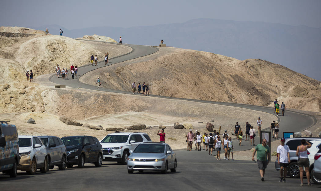 Visitors at Zabriskie Point in Death Valley National Park, Calif., on Tuesday, Aug. 7, 2018. Chase Stevens Las Vegas Review-Journal @csstevensphoto
