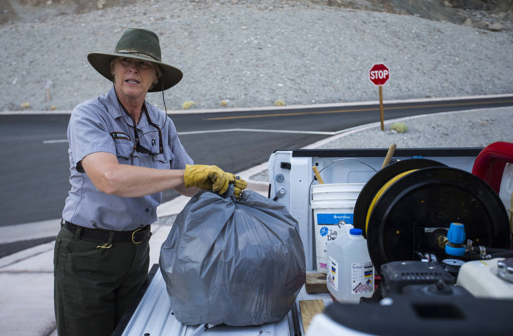 Death Valley National Park custodian Terry Eddington picks up trash at Badwater Basin in Death Valley National Park, Calif., on Tuesday, Aug. 7, 2018. Chase Stevens Las Vegas Review-Journal @csste ...