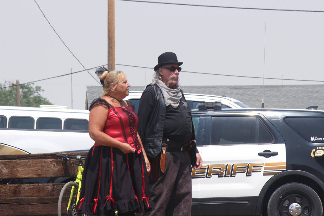 Jeffrey Meehan/Pahrump Valley Times Individuals dressed in period-specific clothing make their way through the crowd during the 2018 Goldfield Days' venue. Dozens of people stop by to check out Go ...