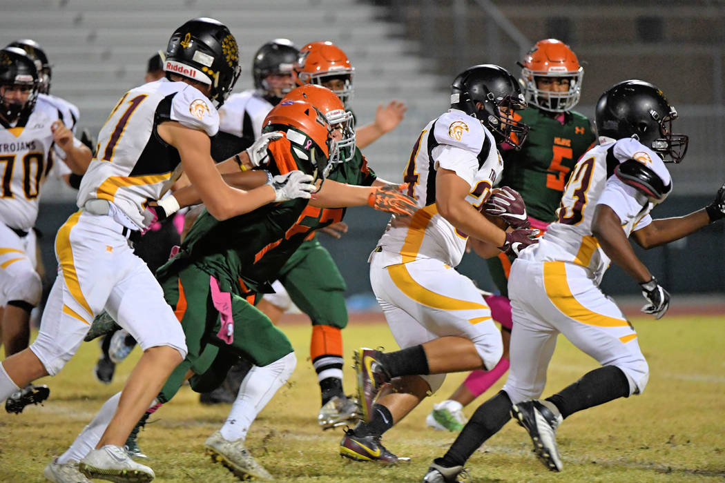 Peter Davis/ Special to the Pahrump Valley Times Senior Nico Velazquez, shown taking off through a big hole for 58 yards last year against Mojave, chewed up 257 yards Friday night in Pahrump Valle ...