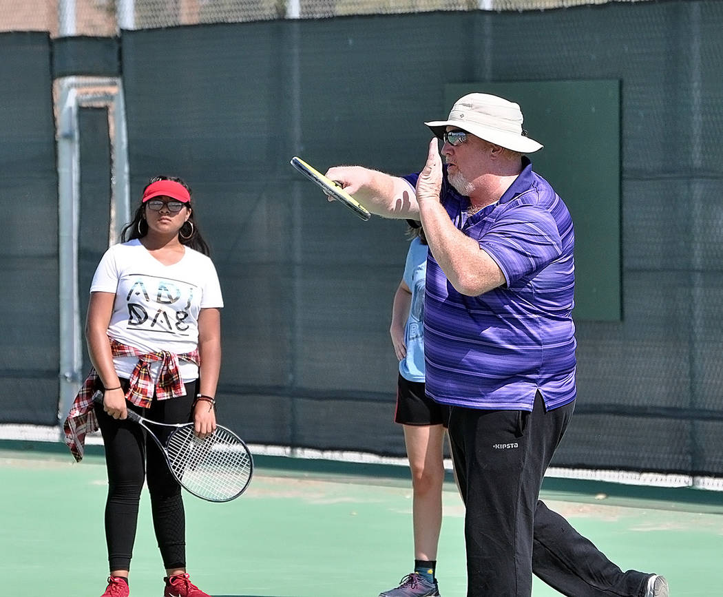 Horace Langford Jr./Pahrump Valley Times Pahrump Valley High School tennis coach David Yost demonstrates proper technique during an Aug. 16 practice at the school.