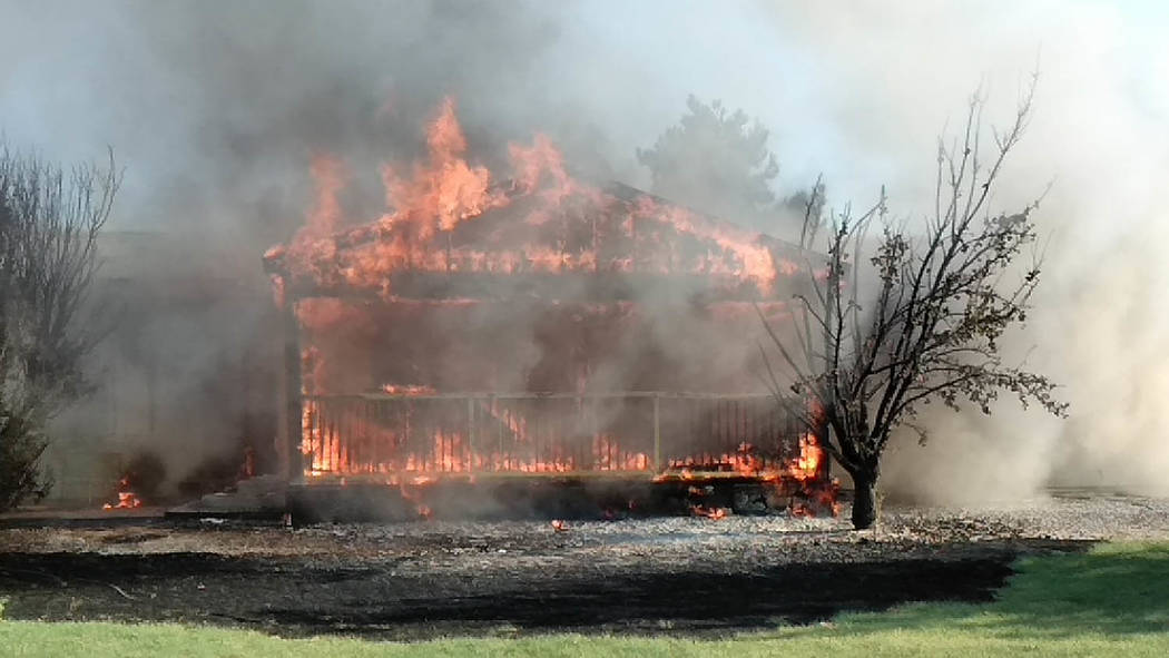 Selwyn Harris/Pahrump Valley Times Two people were medically assessed for smoke inhalation after a late afternoon structure fire destroyed a home along the 3200 block of East Paiute Boulevard on T ...