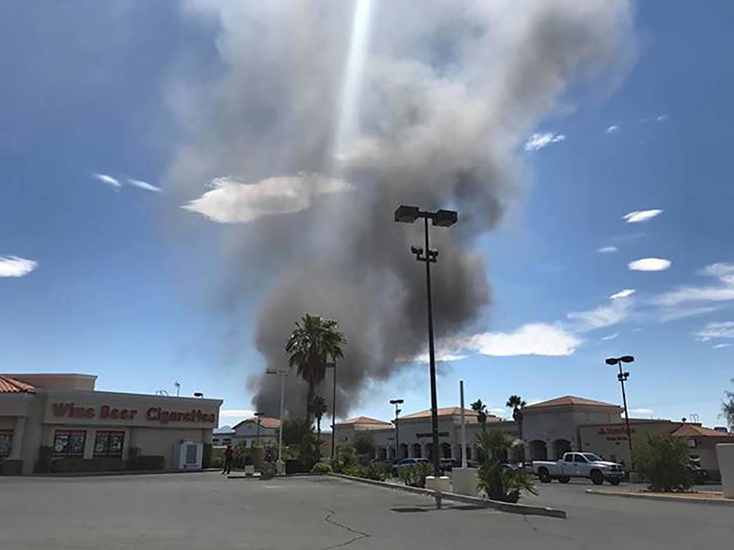 Philip Northcutt/Special to the Pahrump Valley Times Smoke is shown rising from behind a shopping center in Pahrump on Tuesday. A fire was reported in a nearby residential area.