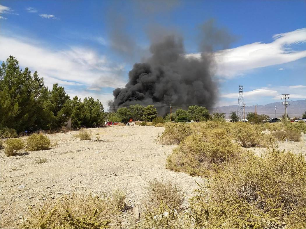 Bob Burningham/Special to the Pahrump Valley Times Reader Bob Burningham provided this photo of the dark smoke rising from the fire in Pahrump on Tuesday afternoon. Pahrump Valley Fire and Rescue ...