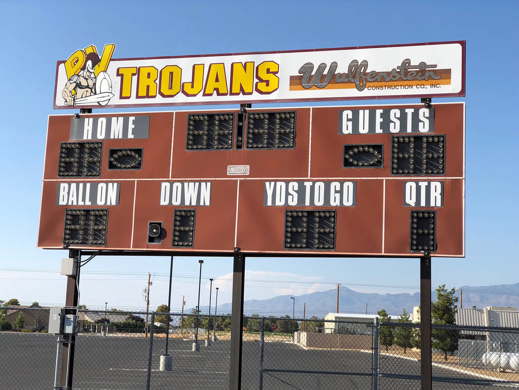 Tom Rysinski/Pahrump Valley Times Pahrump Valley supporters look forward to seeing the number on the upper left of the stadium scoreboard increase quickly during the Trojans' home opener against V ...