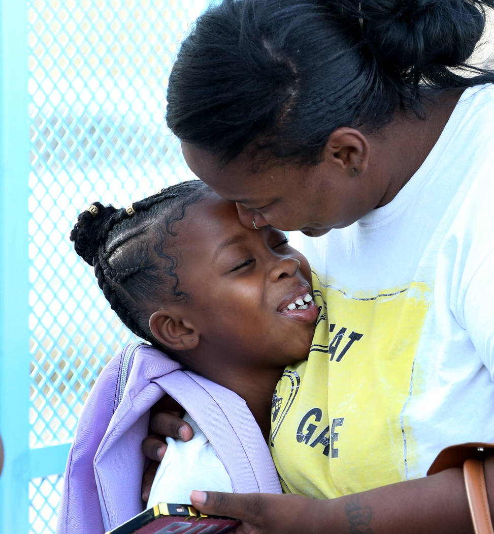 Chanell Wilson says goodbye to her daughter Constance Shabazz, 8, before she heads off to the first day of school at Kelly Elementary School on Monday, Aug. 13, 2018, in North Las Vegas. Bizuayehu ...