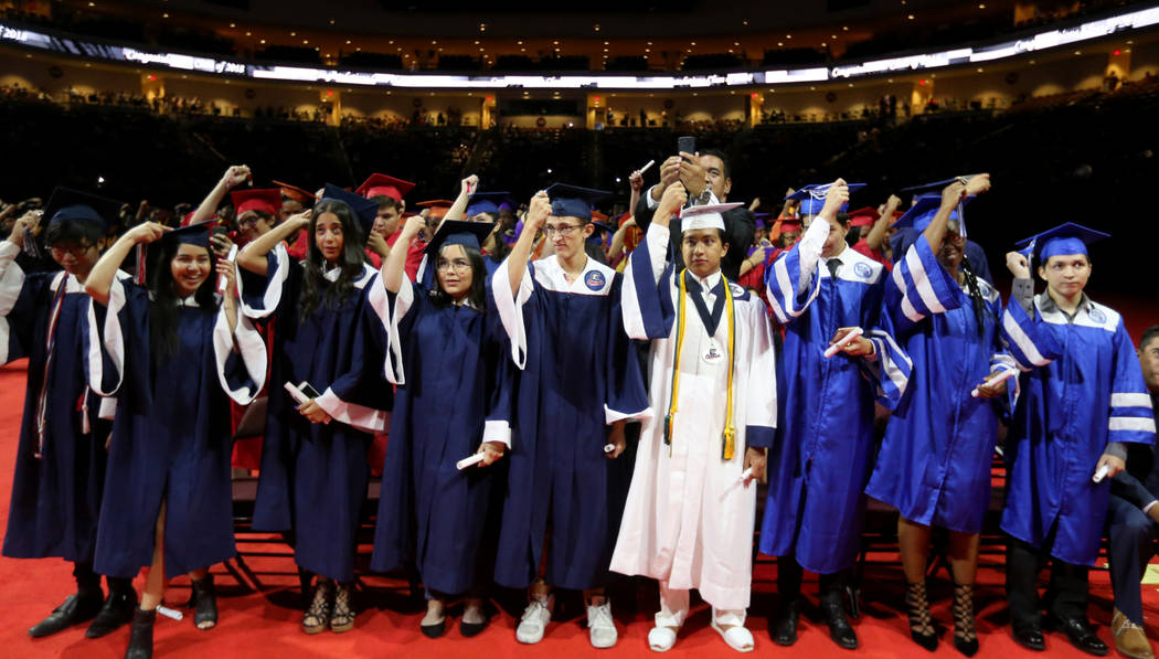 Students turn their tassels during Clark County School District summer graduation ceremony on Tuesday, Aug. 7, 2018, at Orleans Arena. For the past seven years, the district has hosted the event t ...