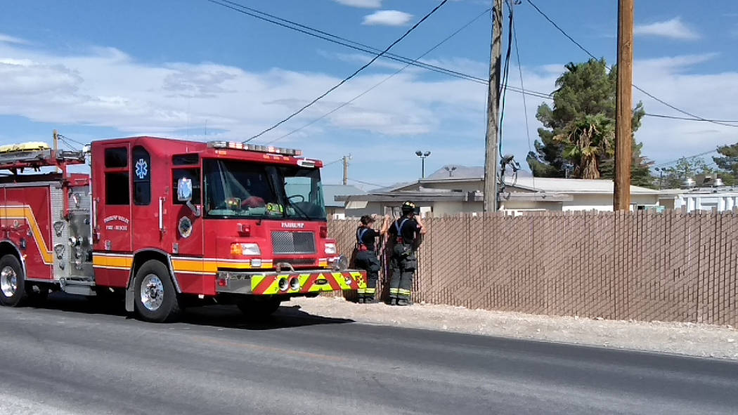 Selwyn Harris/Pahrump Valley Times Pahrump Valley Fire and Rescue crews assess a small fire at the NyE Communities Coalition campus on Tuesday morning just after 10 a.m. Valley Electric Associatio ...