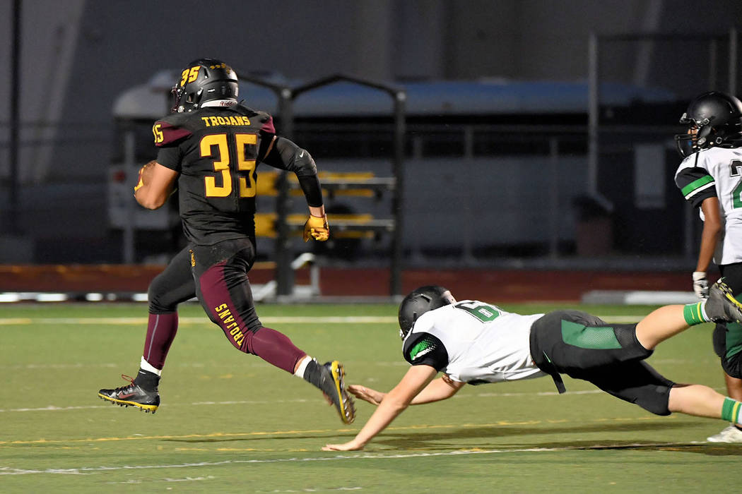 Peter Davis/Special to the Pahrump Valley Times Senior back Nico Velazquez breaks loose for one of his three touchdowns for Pahrump Valley against Virgin Valley during Friday night's game in Pahrump.