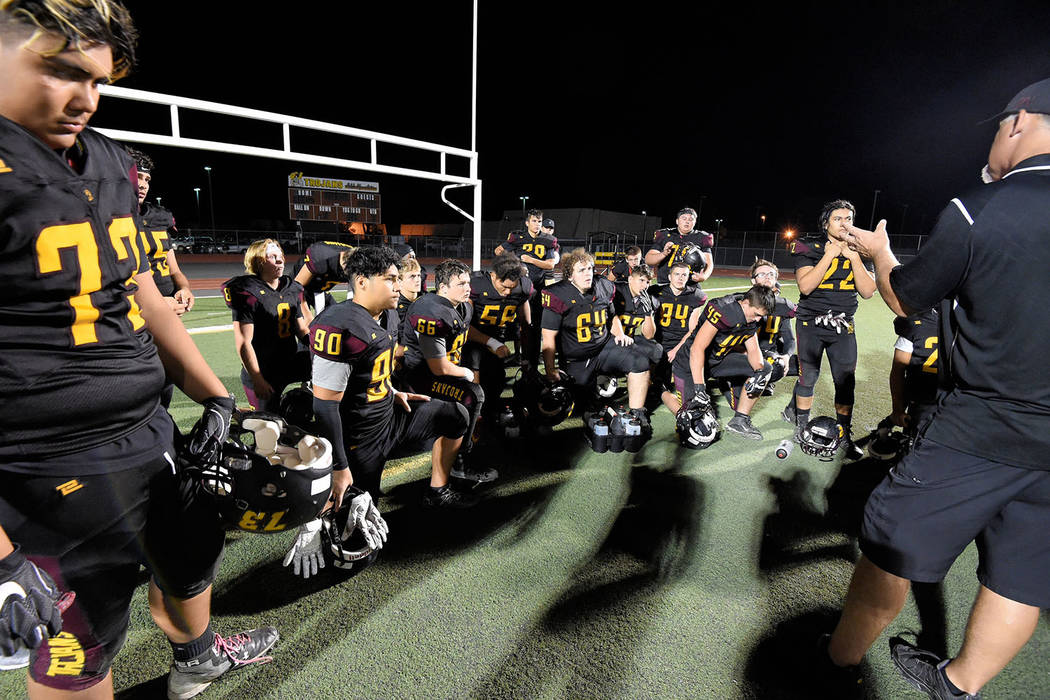 Peter Davis/Special to the Pahrump Valley Times Pahrump Valley players listen to a postgame talk from their coaches after a 26-24 defeat against Virgin Valley on Friday night in Pahrump.