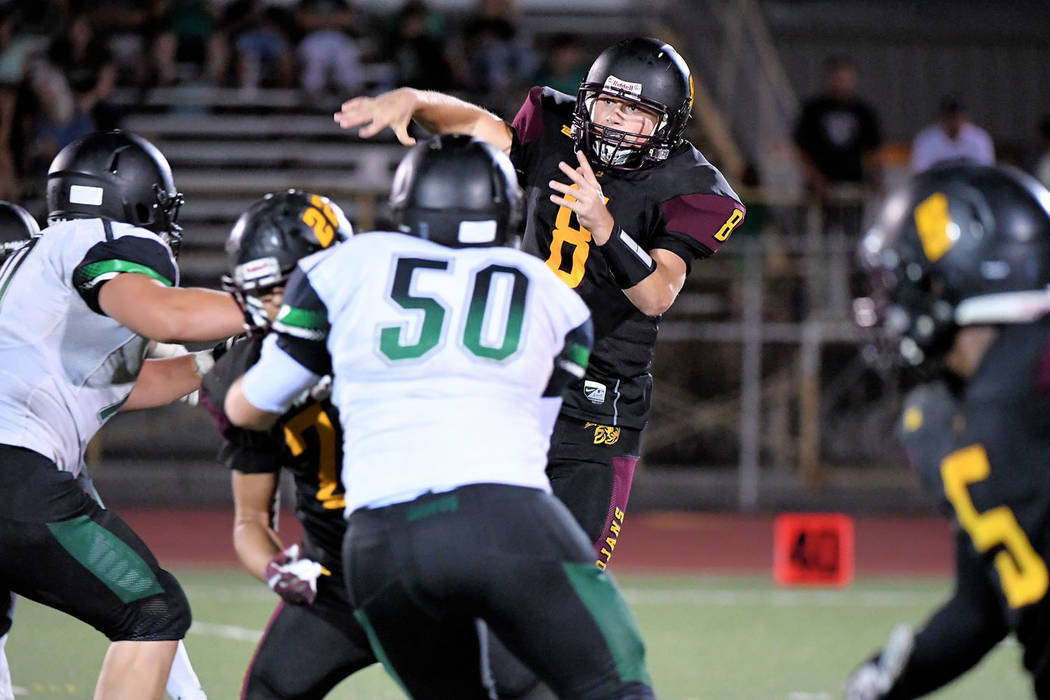 Peter Davis/Special to the Pahrump Valley Times Pahrump Valley senior quarterback Tyler Floyd unleashes a pass during Friday night's game against Virgin Valley in Pahrump.