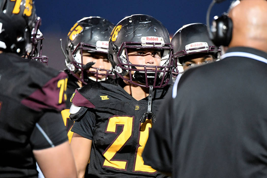 Peter Davis/Special to the Pahrump Valley Times Dylan Grossell (28) listens intently to instructions during Pahrump Valley's 26-24 loss to Virgin Valley on Friday night in Pahrump.