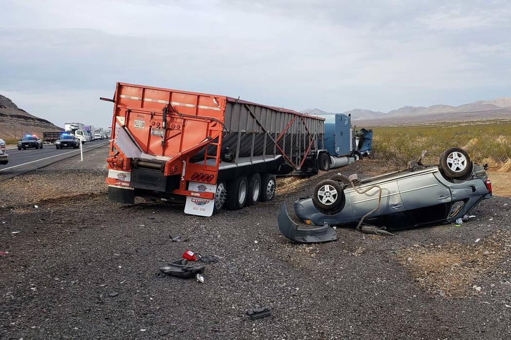 The Nevada Highway Patrol investigates a fatal crash, north of Las Vegas, near Coyote Springs, Wednesday, July 18, 2018. According to the Nevada Highway Patrol, a dozing truck driver slammed into ...
